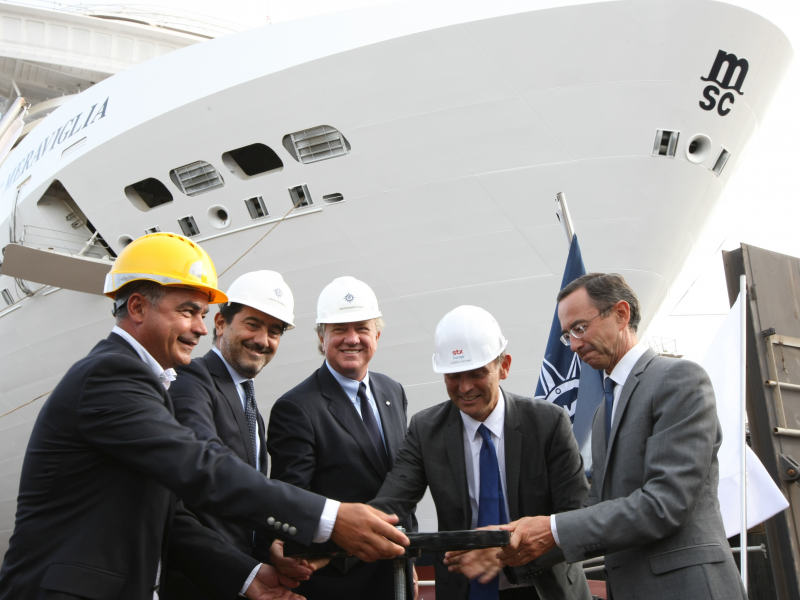 1-msc-cruises-executives-mr-pierfrancesco-vago-and-mr-gianni-onorato-open-the-valve-with-stx-director.jpeg