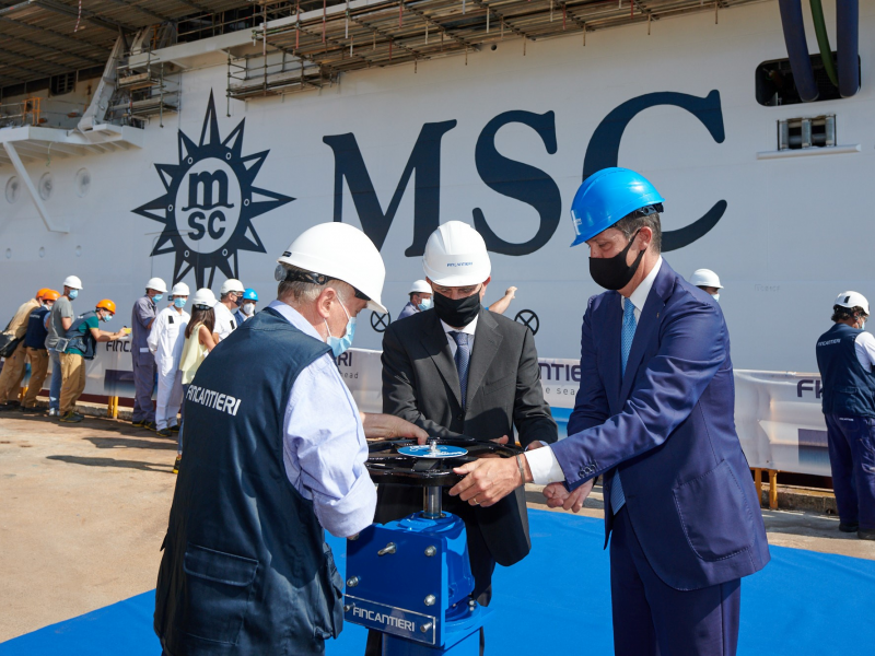 msc-cruises-and-fincantieri-representatives-together-open-the-valves-at-todays-msc-seashore-float-out-ceremony-2.jpeg